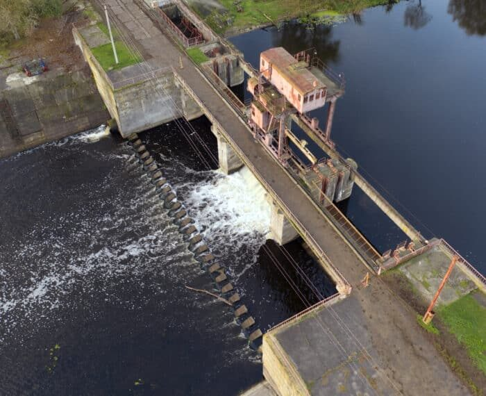 Hydroelectric power station on a small river. Renewable energy source.
